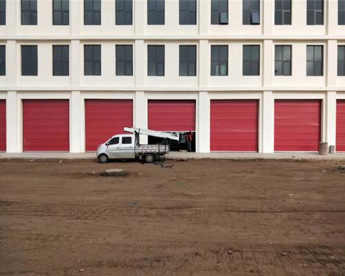 蘭州新區裝備園區消防中隊工業滑升門安裝